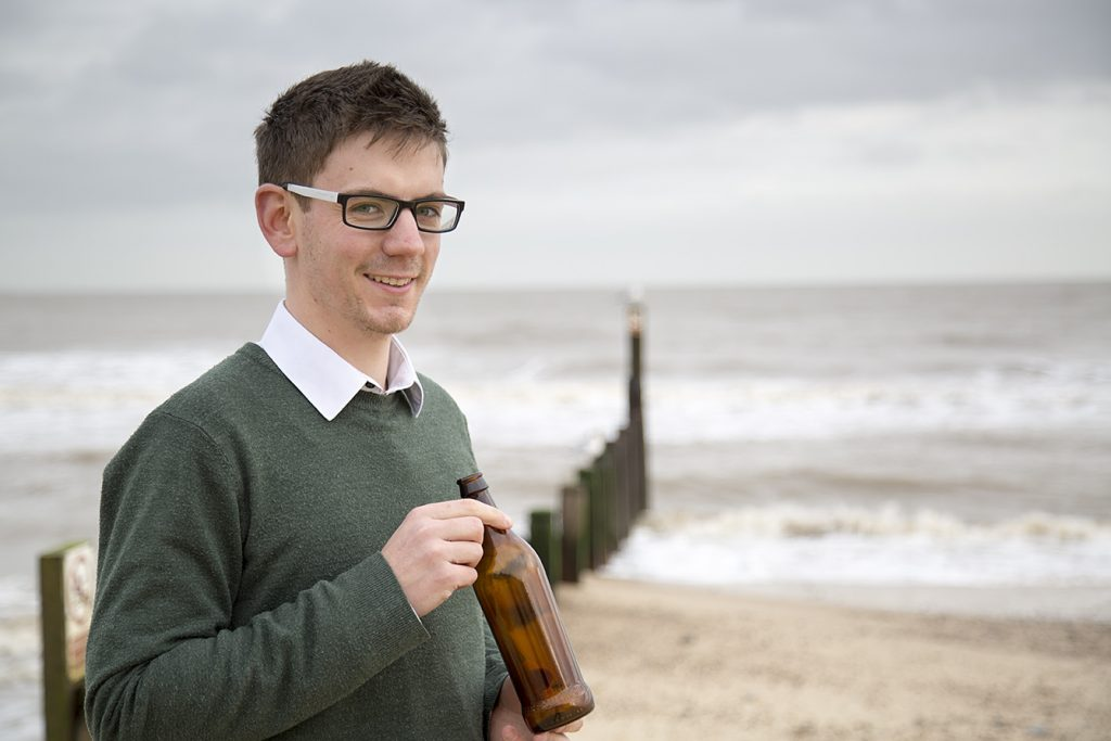 Sustainability Manager Ben Orchard, with the lighter weight brown glass bottle
